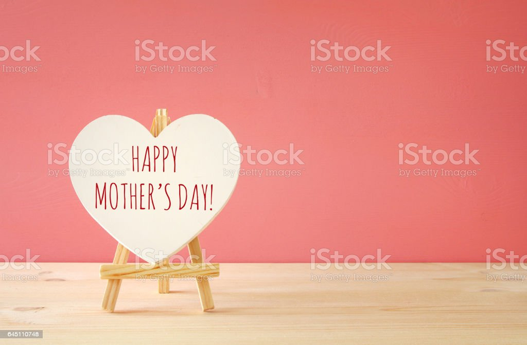 mother's day concept image. Board by heart shape stock photo