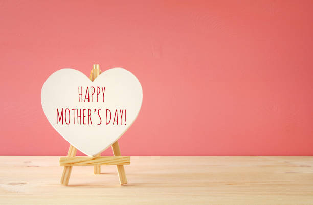 mother's day concept image. board by heart shape - mothers day stock photos and pictures