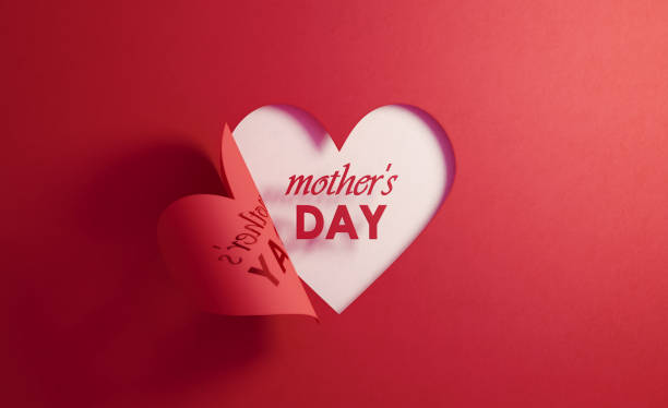 mother's day concept- mother's day text inside of a red folding heart shape on white background - mothers day stock pictures, royalty-free photos & images