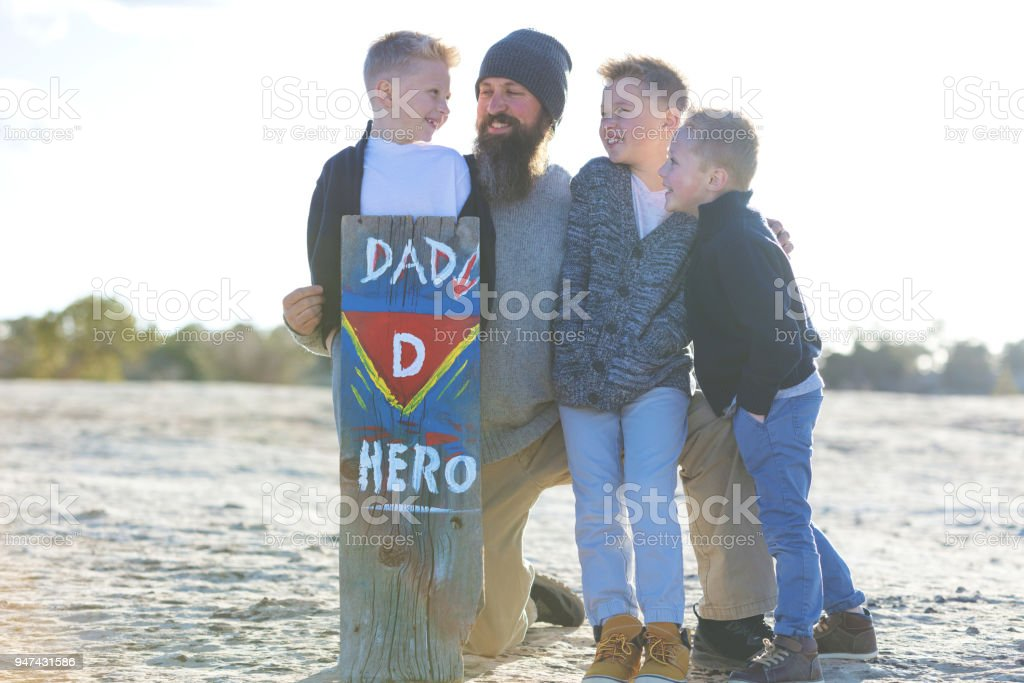 Mother's Day - Father Sons Superhero sign Family in Rural Colorado West stock photo