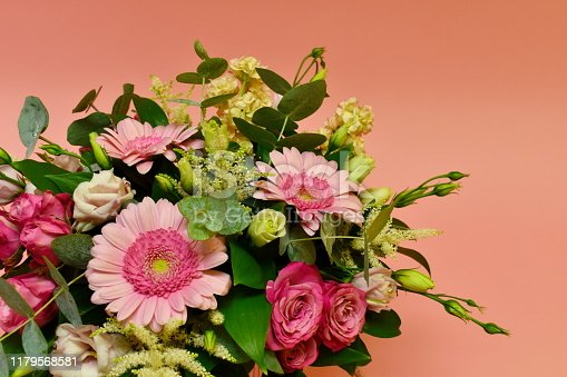 Fragment of a bouquet of flowers on a pink background. Live beautiful flowers blank for the designer. Copyspace