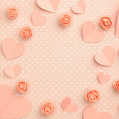 istock Mothers day floral frame composition. Love Day background with coral or pink flowers rose shape heart flat lay. Valentines day, 8 March Women day. Top view 1133003289