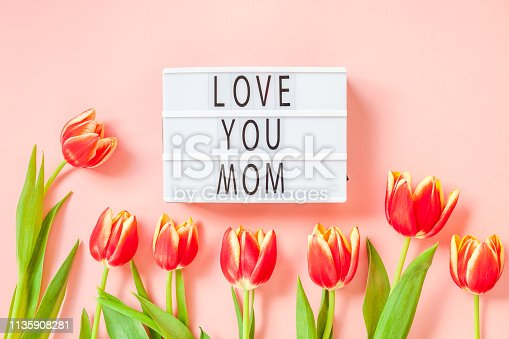 659293084istockphoto Mothers Day greeting card with red tulip flowers 1135908281