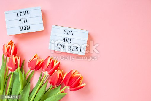 659293084istockphoto Mothers Day greeting card with red tulip flowers 1135908411