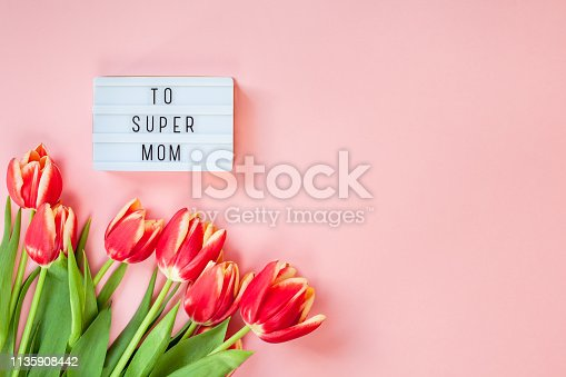 659293084istockphoto Mothers Day greeting card with red tulip flowers 1135908442
