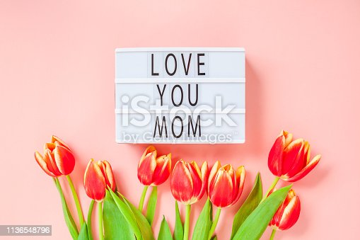 659293084 istock photo Mothers Day greeting card with red tulip flowers 1136548796