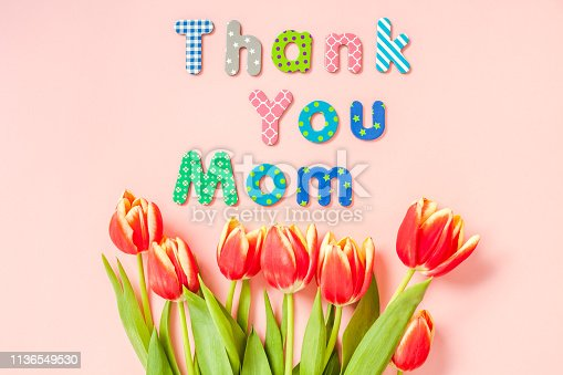 659293084 istock photo Mothers Day greeting card with red tulip flowers 1136549530