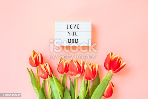 659293084 istock photo Mothers Day greeting card with red tulip flowers 1136549595