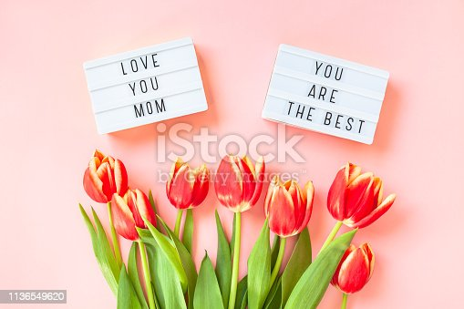659293084istockphoto Mothers Day greeting card with red tulip flowers 1136549620