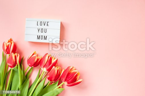 659293084 istock photo Mothers Day greeting card with red tulip flowers 1136549700