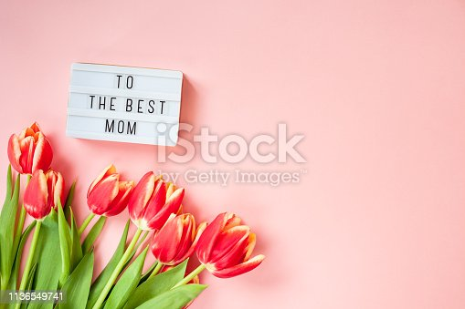 659293084istockphoto Mothers Day greeting card with red tulip flowers 1136549741