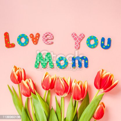 659293084 istock photo Mothers Day greeting card with red tulip flowers 1136960136