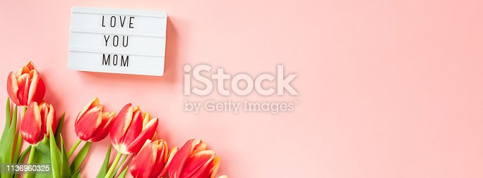 659293084 istock photo Mothers Day greeting card with red tulip flowers 1136960325