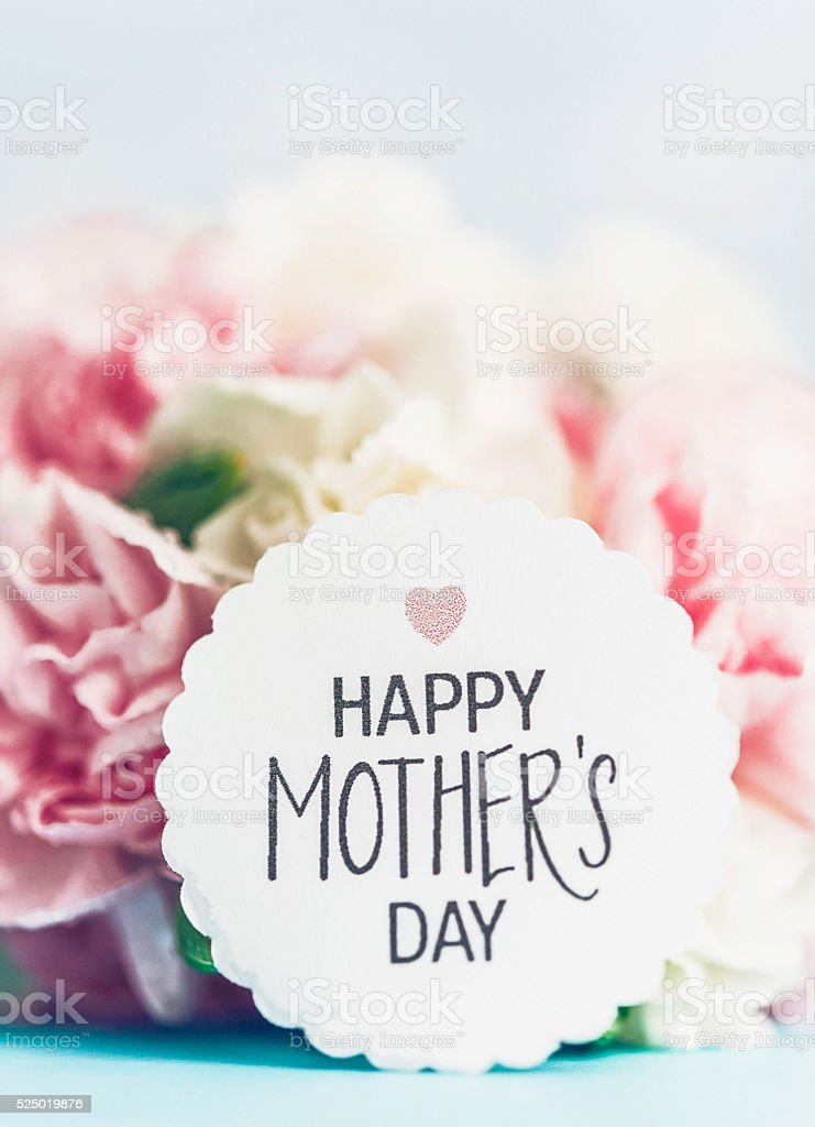 Mother's Day message with assorted pastel carnation blooms stock photo