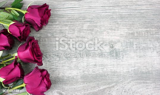 921112244 istock photo Mother's Day Pink Roses Over Wooden Background 903104148