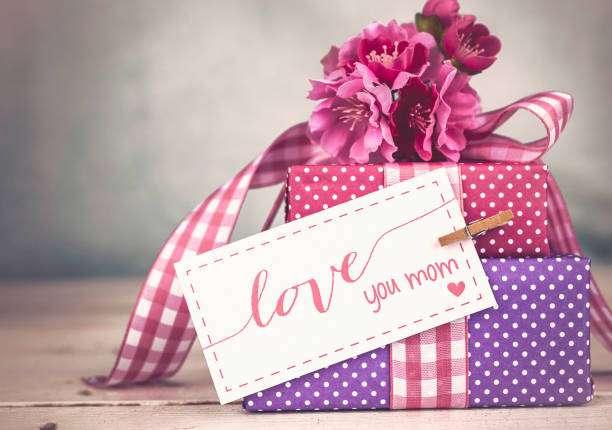 mother's day still life arrangement - gift tag note stock photos and pictures
