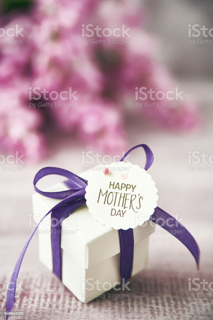 Mother\'s Day still life arrangement with gift, message and flowers