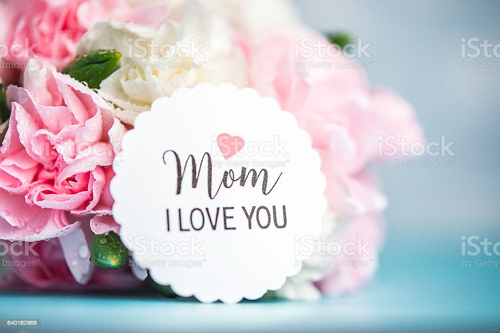 Mother's Day still life. Pastel colored flowers with message - foto de acervo