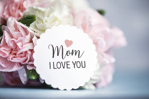 mother's day still life. pastel colored flowers with message - i love you stock photos and pictures