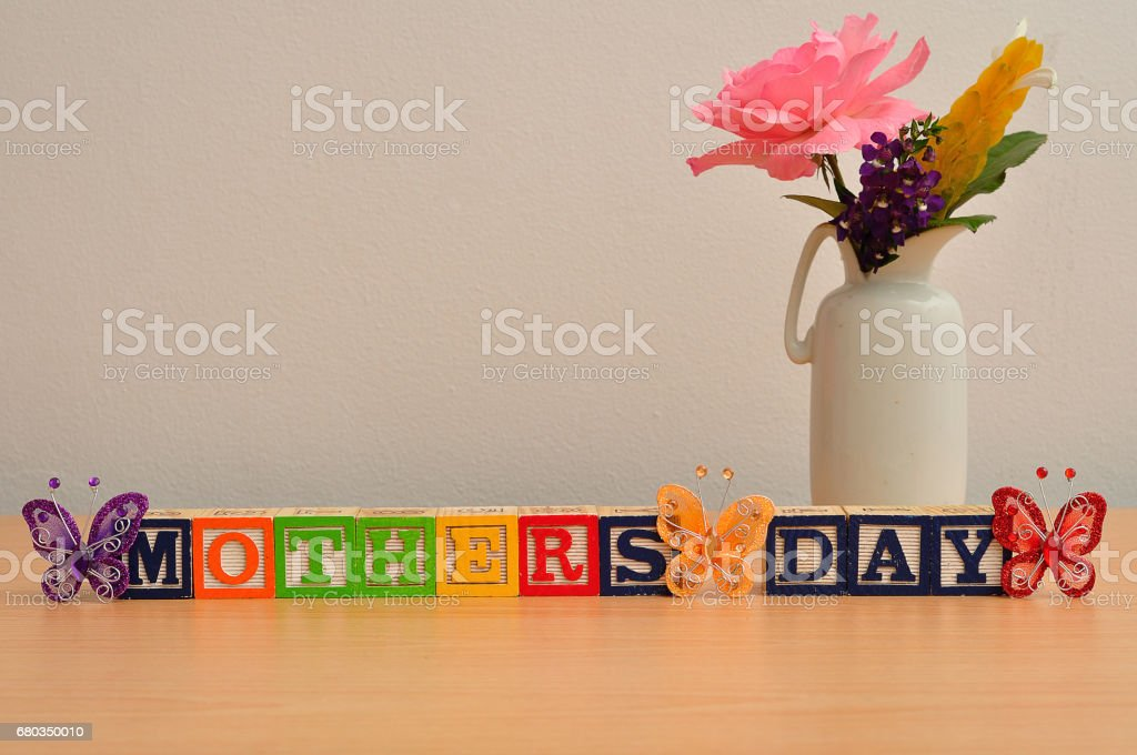 Mothers day  with a colorful flowers and silk butterflies royalty-free stock photo