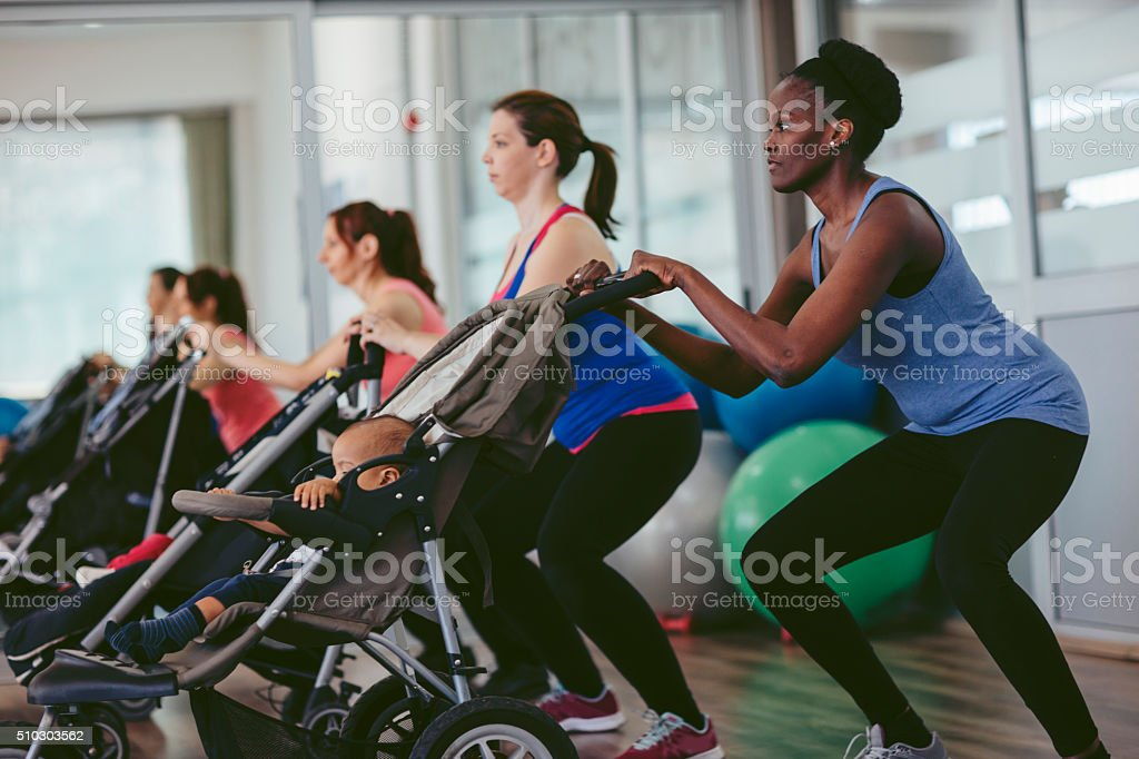 Mothers Exercise with Their Babies stock photo