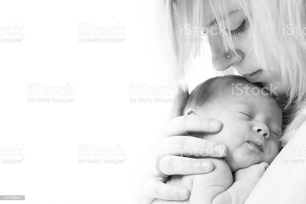 Mothers face and her little child stock photo