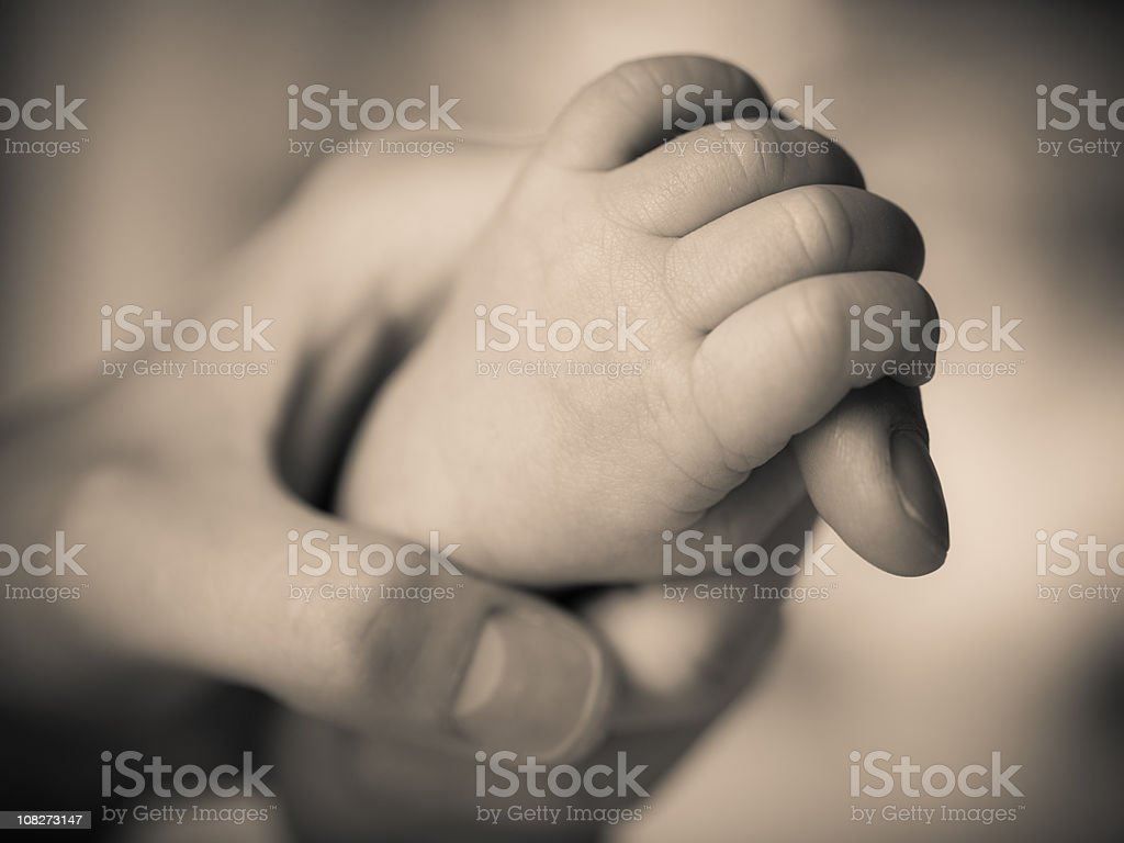 Mother's Hand Holding Newborn's royalty-free stock photo