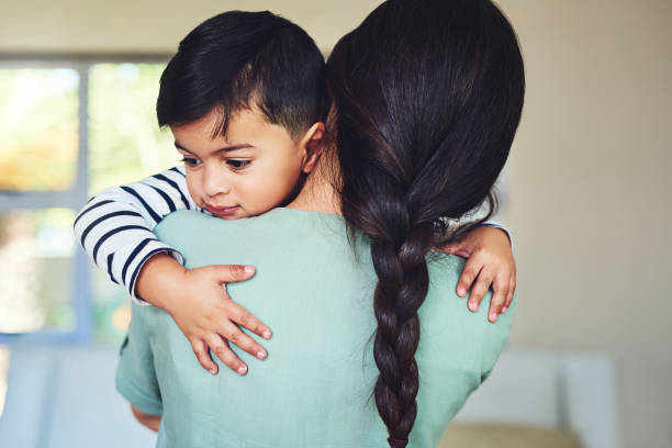 A mother's hug is filled with the most love stock photo