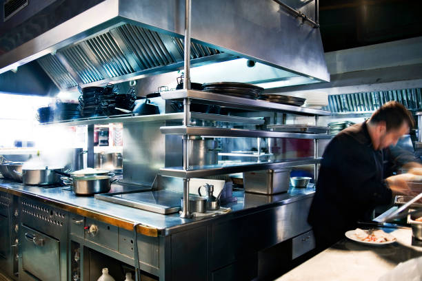 motion blue of chef cooking in restaurant kitchen - busy restaurant kitchen stock pictures, royalty-free photos & images