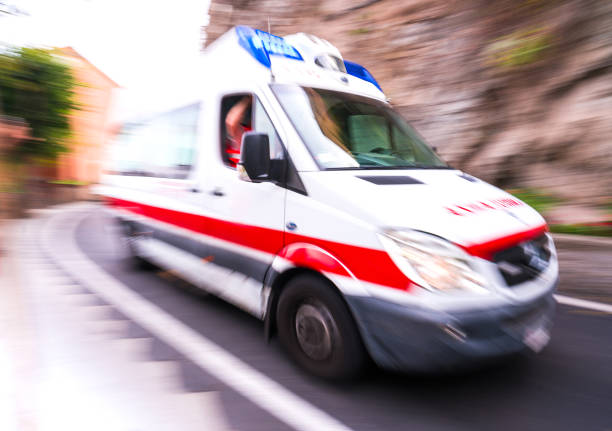 Motion blur ambulance in Italy stock photo