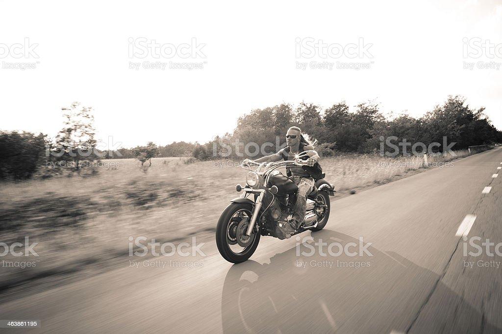 Motion Blur Biker On Countryside stock photo