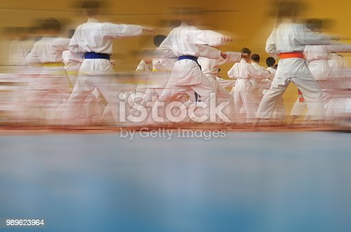 istock Motion blur Blurred Background. Children's training on karate. 989623964