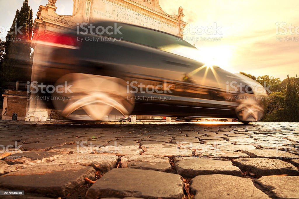 Motion blur car in Rome at sunset stock photo