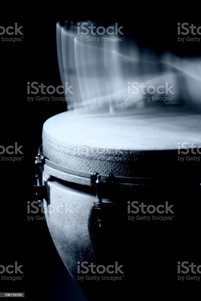 Motion Blur Hands Drumming on Bongo, Black and White stock photo
