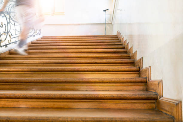motion blur, man goes upstairs, old wooden stairs stock photo