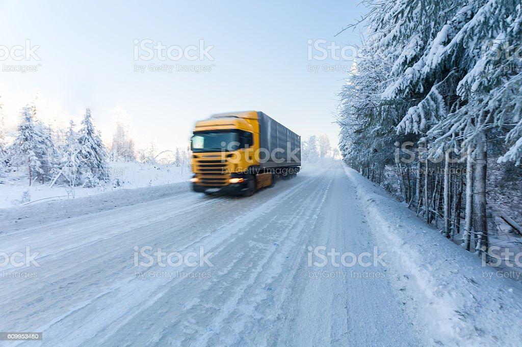 Motion blur of a  truck on winter road – Foto
