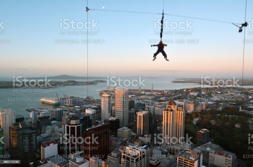 Motion blur of a young person jumps off Auckland city Sky Tower stock photo