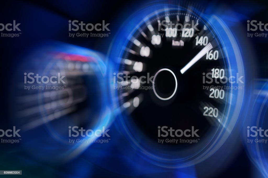 Motion blur of car dashboard with blue illuminated display stock photo