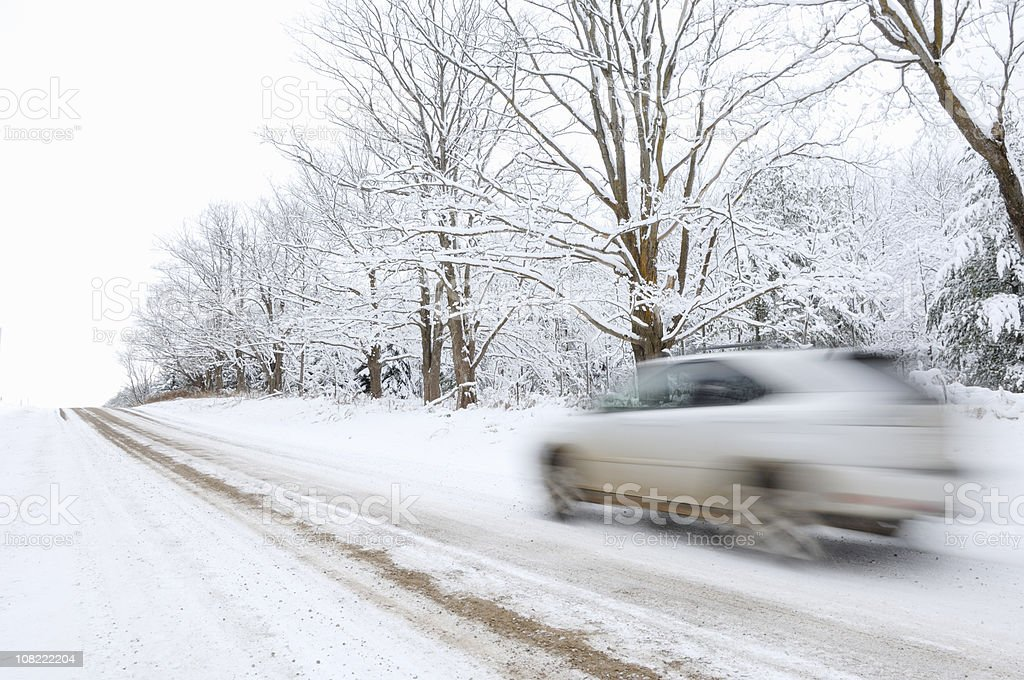 Motion Blur of Car Driving Down Snow Covered Road royalty-free stock photo
