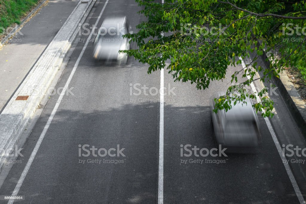 Motion blur of cars in aerial view over the road.