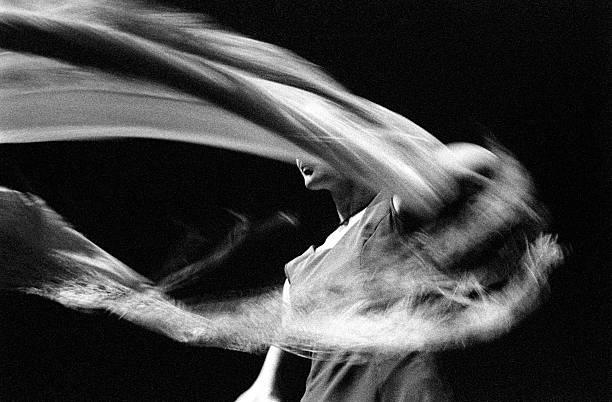 Motion Blur of Female Flamenco Dancer, Black and White stock photo