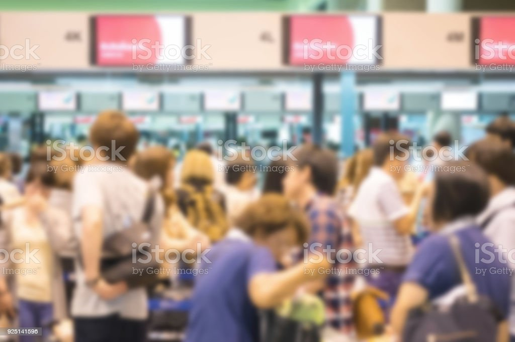 Motion blur of group of people waiting for check in at the airport