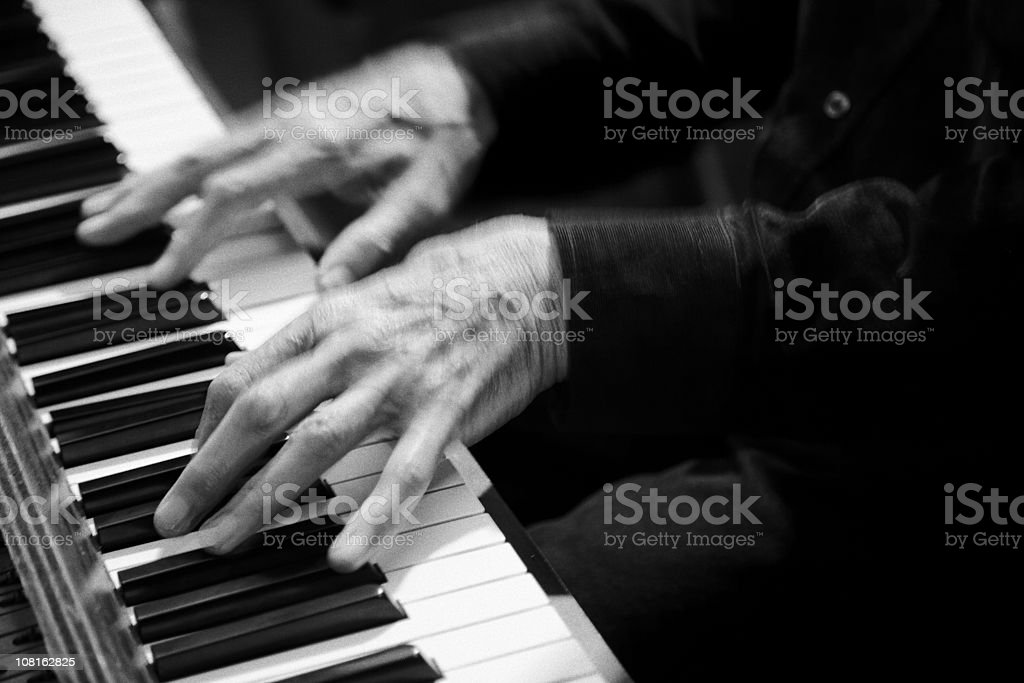 Motion Blur of Hands Playing Piano, Black and White royalty-free stock photo