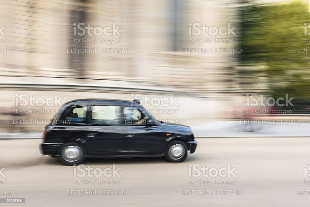 Motion blur of london taxi cab stock photo