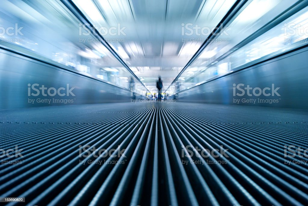 motion blur of moving escalator in airport royalty-free stock photo