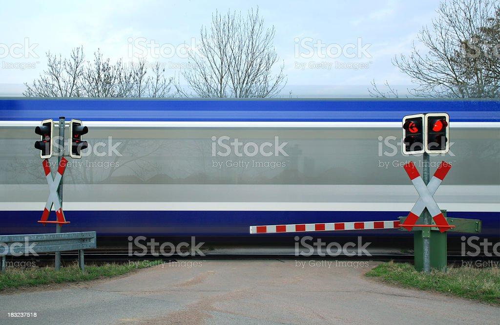 Motion Blur of Passenger Train at Rail Road Crossing royalty-free stock photo