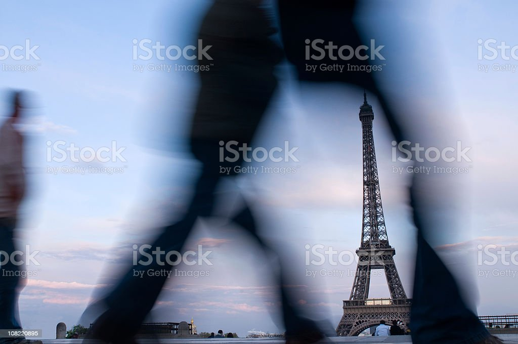Motion Blur of People Walking by Eiffel Tower royalty-free stock photo