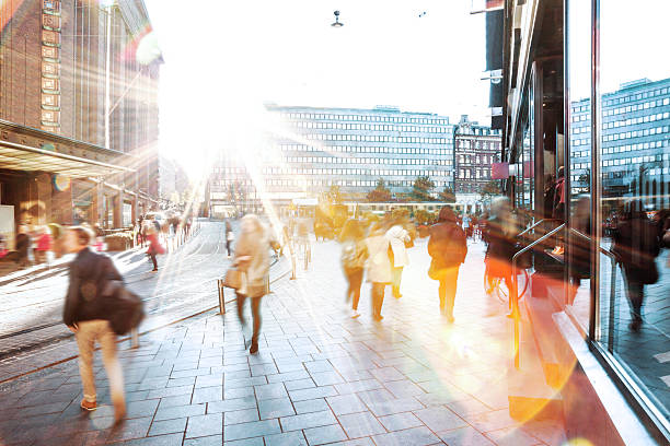 motion blur of people walking in the city - finland stock pictures, royalty-free photos & images
