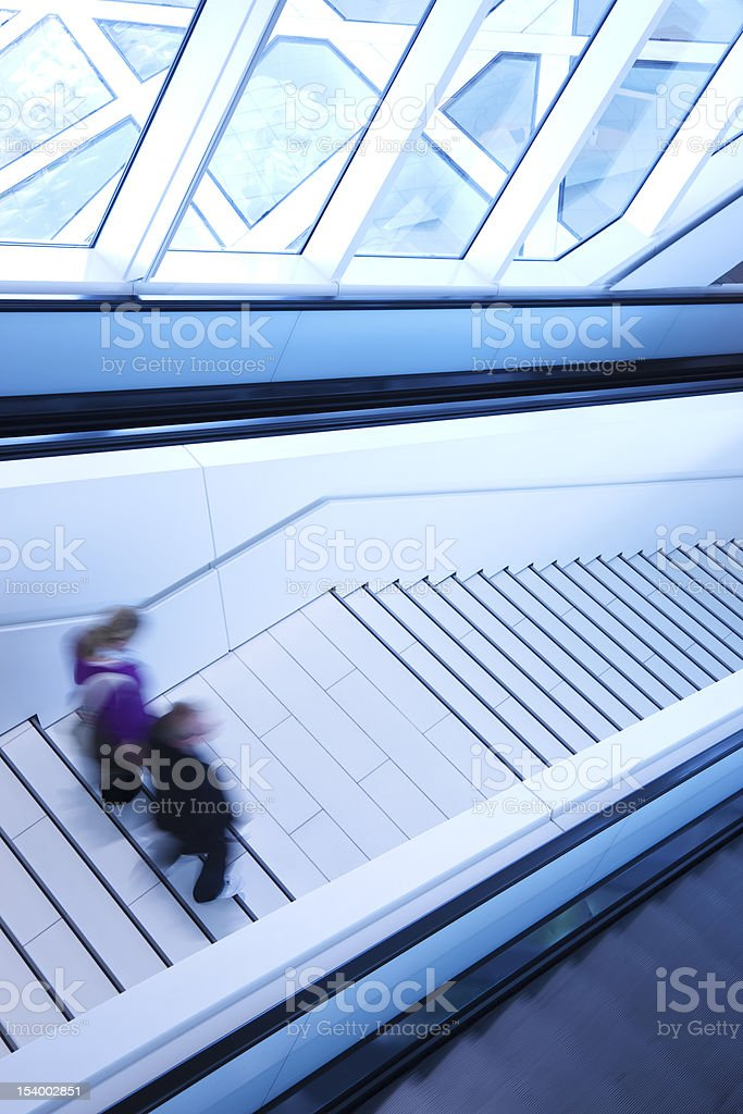 Motion Blur of People Walking on Stairs, Toned Image royalty-free stock photo