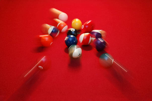 Motion Blur of Pool Balls Scattering on Red Table stock photo